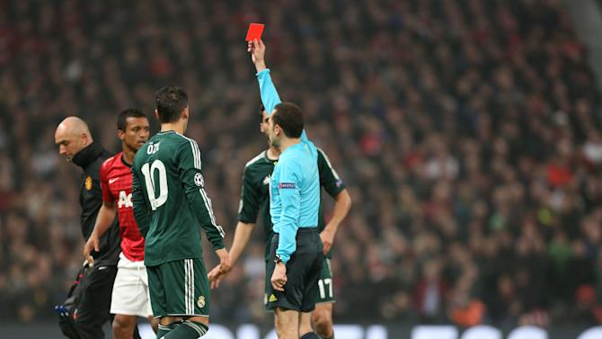 Manchester United's Nani, 2nd left, is shown a red card during the Champions League round of 16 soccer match against Real Madrid at Old Trafford Stadium, Manchester, England, Tuesday, March 5, 2013. (AP Photo/Jon Super)