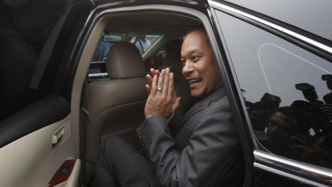 Red Shirt leader and former Commerce Minister Nattawut gestures while leaving a military barrack in Bangkok