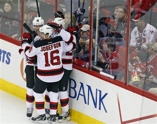 Devils clinch playoff spot by routing 'Canes 5-0
