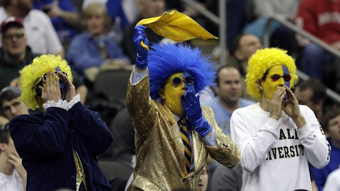 La Salle fans cheer during the first half of a third-round game against Mississippi in the NCAA college basketball tournament on Sunday, March 24, 2013, in Kansas City, Mo. (AP Photo/Charlie Riedel)