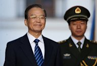 China's Premier Wen Jiabao (shown in Santiago, Chile on June 26) warned Sunday that his nation's economic rebound was not stable and the world's second largest economy faced hardships ahead, state media reported. China's economy expanded during the second quarter at its slowest pace in more than three years as dire problems overseas started to hit home, according to official data
