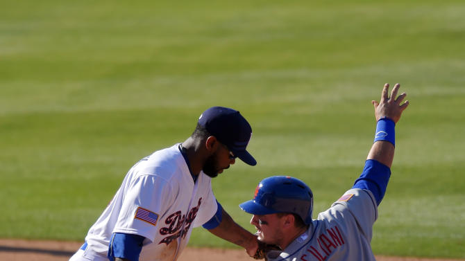 Los Angeles Dodgers shortstop Jimmy Rollins, left, puts a late tag on New York Mets' Darrell Ceciliani as Ceciliani steals second during the fourth inning of a baseball game, Saturday, July 4, 2015, in Los Angeles. (AP Photo/Mark J. Terrill)