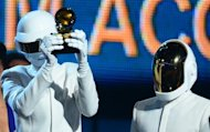 Daft Punk celebrate on stage during the 56th Grammy Awards at the Staples Center in Los Angeles, California, January 26, 2014