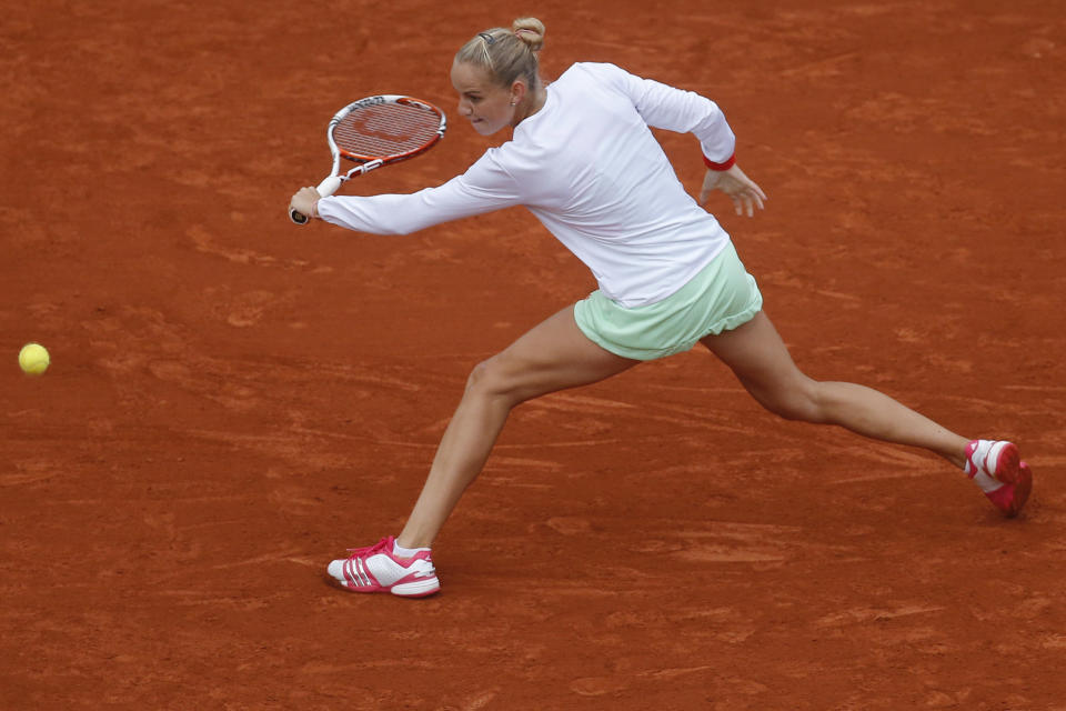 Arantxa Rus of The Netherlands returns in her fourth round match against Kaia Kanepi of Estonia at the French Open tennis tournament in Roland Garros stadium in Paris, Monday June 4, 2012. Rus lost in three sets. (AP Photo/Michel Euler)
