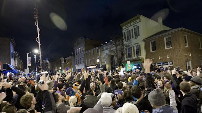 Baltimore Ravens fans celebrate in the streets in downtown Baltimore after their team won the Super Bowl in an NFL football game against the San Francisco 49ers, Sunday, Feb. 3, 2013. (AP Photo/Jose Luis Magana)