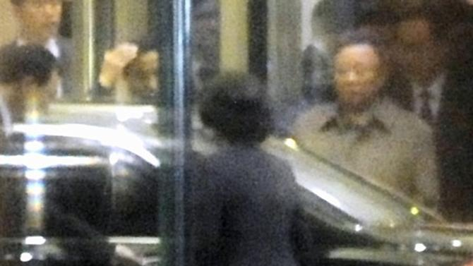 North Korean leader Kim Jong Il, second from right, leaves a hotel in Mudanjiang in northeastern China Friday afternoon, May 20, 2011. Kim Jong Il, who rarely travels abroad, made an unusual third trip in just over a year Friday to his country's main ally and benefactor, China, news agencies reported. The trip set off a media frenzy because many initially reported it was his son and heir apparent, Kim Jong Un, who had crossed the border, a reflection of the difficulty of getting information from or about North Korea. (AP Photo/Kyodo News) JAPAN OUT, MANDATORY CREDIT, NO LICENSING IN CHINA, HONG KONG, JAPAN, SOUTH KOREA AND FRANCE