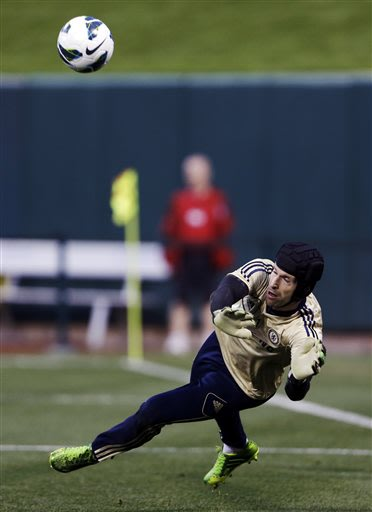 Chelsea goalkeeper Petr Cech, of the Czech Republic, deflects a shot during a soccer training session Wednesday, May 22, 2013, at Busch Stadium in St. Louis. Chelsea is scheduled to play an exhibition