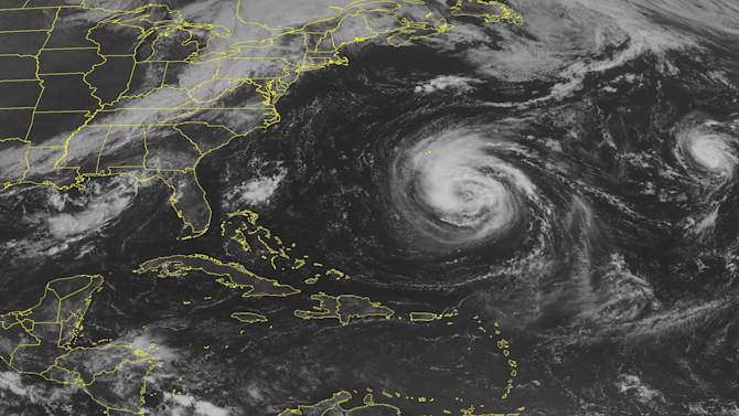 This NOAA satellite image taken Saturday, Sept. 8, 2012 at 10:45 AM EDT shows Tropical Storm Leslie moving Northward in the central Atlantic ocean and Hurricane Michael moving Northwest in the eastern Atlantic ocean. Leslie has maximum winds of 65 mph and is expected to bring tropical storm conditions to Bermuda by Sunday morning. Michael is currently a Category 2 Hurricane with maximum winds at 105 mph. This small yet strong storm is expected to slowly weaken over the next two days. (AP Photo/Weather Underground)