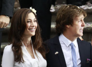 Former Beatle Sir Paul McCartney and his wife American heiress Nancy Shevell leave Marylebone Registry Office, following their wedding in central London, Sunday Oct. 9, 2011. Shevell, 51, is McCartney's third wife.The couple met in the Hamptons in Long Island, New York, shortly after the singer's divorce from Heather Mills in 2008 and they were engaged earlier this year. (AP Photo/Lefteris Pitarakis)