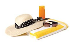 Beach hat, sunglasses, and towel