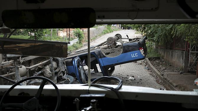 Overturned police vehicle is seen after clashes between striking miners and riot police at Mina El Limon town, Nicaragua