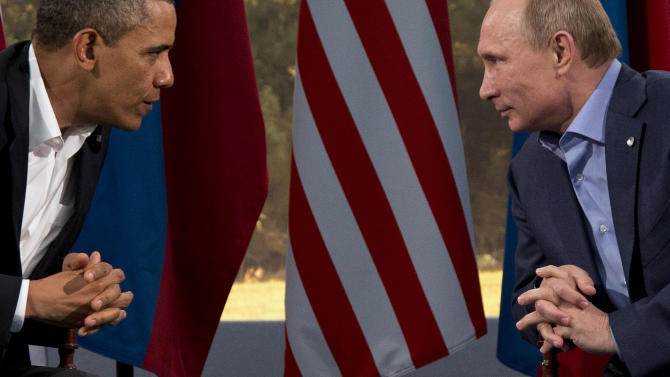 FILE - This June 17, 2013 file photo shows President Barack Obama meeting with Russian President Vladimir Putin in Enniskillen, Northern Ireland. President Barack Obama brushed aside sharp European criticism on Monday, suggesting all nations spy on each other, as the French and Germans expressed outrage over alleged U.S. eavesdropping on European Union diplomats. American analyst-turned-leaker Edward Snowden, believed to be stranded for the past week at Moscow's international airport, applied for political asylum to remain in Russia. (AP Photo/Evan Vucci, File)
