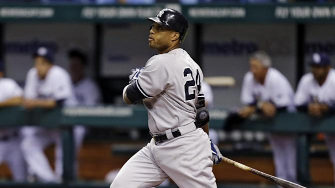 New York Yankees' Robinson Cano follows the flight of his first-inning, two-run home run off Tampa Bay Rays starting pitcher Alex Cobb during a baseball game, Tuesday, Sept. 4, 2012, in St. Petersburg, Fla. Yankees' Nick Swisher also scored on the hit. (AP Photo/Chris O'Meara)
