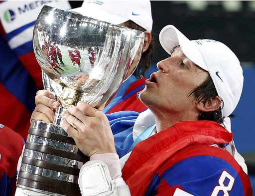 Russia's Ovechkin kisses trophy after their victory at the 2012 IIHF men's ice hockey World Championship final game with Slovakia in Helsinki