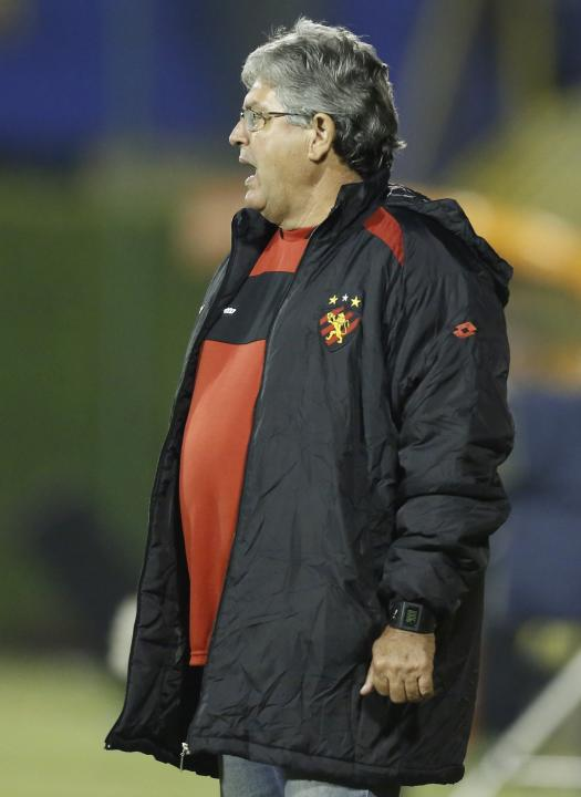 Eugenio Machado, coach of Brazil's Sport Recife, shouts from the sidelines of a Copa Sudamericana soccer game with Paraguay's Libertad in Asuncion, Paraguay, Wednesday, Sept. 25, 2013