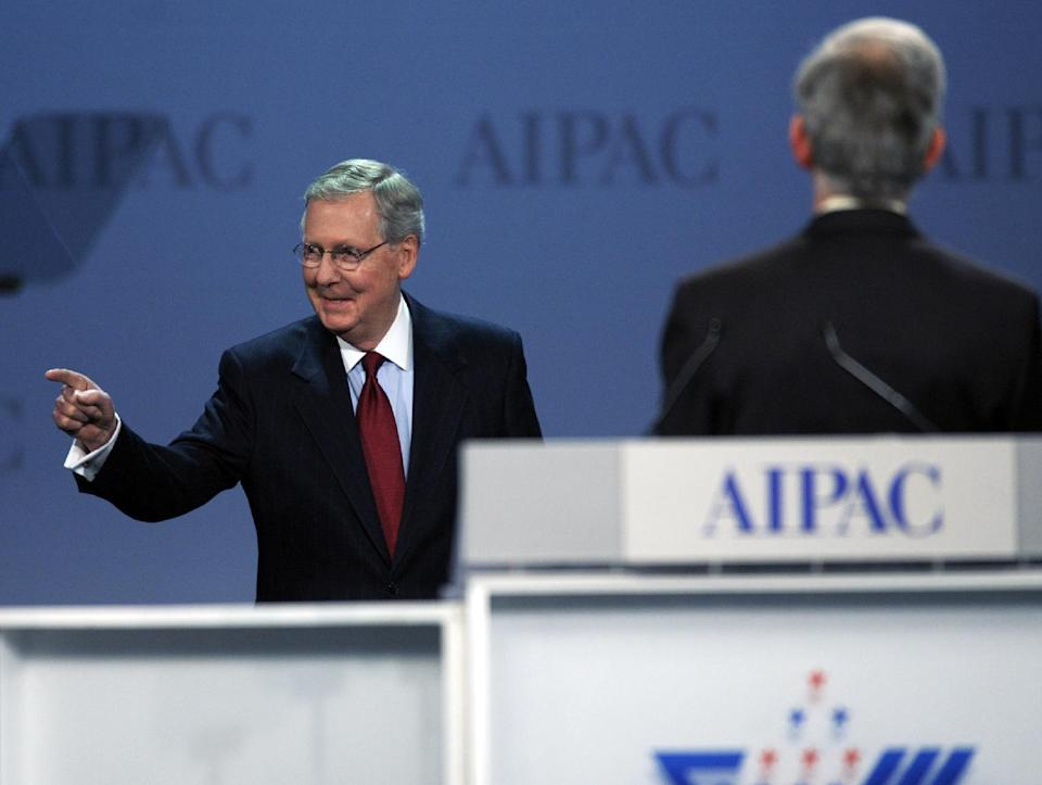 Senate Minority Leader Mitch McConnell, R-Ky., left, walks on-stage to address the American Israel Public Affairs Committee (AIPAC) Policy Conference opening plenary session in Washington, Monday, March 5, 2012. (AP Photo/Cliff Owen)