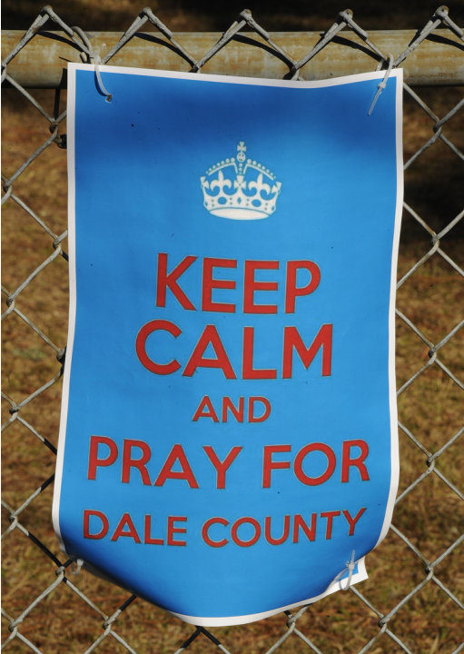 A sign encouraging prayer for a 5-year-old boy being held hostage, hangs on a fence surrounding Midland City Elementary school Wednesday, Feb. 3, 2013, in Midland City, Ala. Authorities say Jim Lee Dy