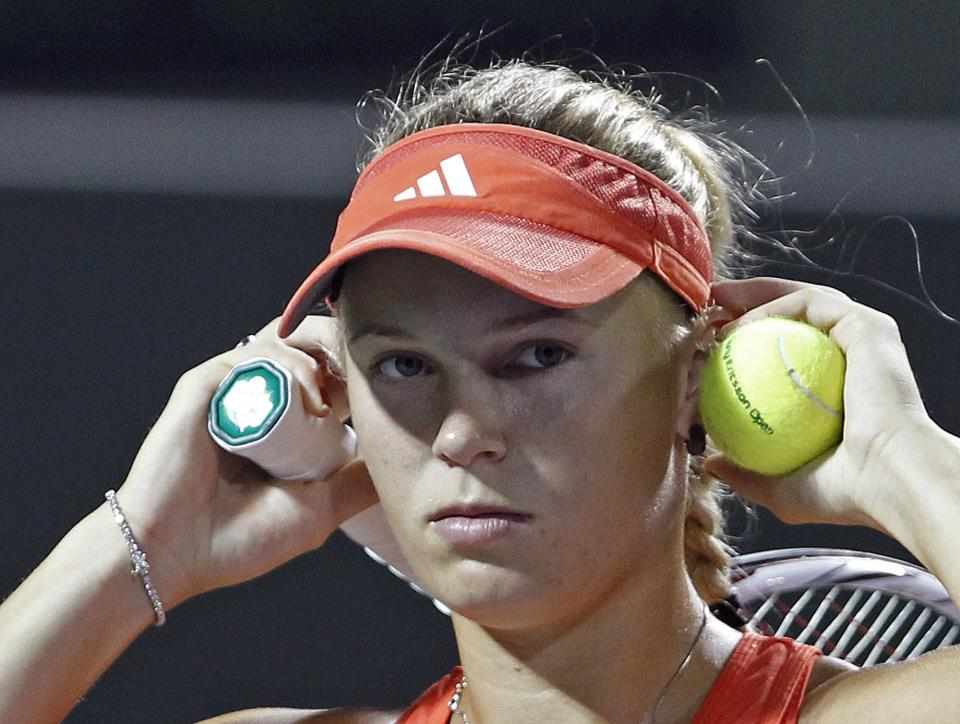 Caroline Wozniacki, of Denmark, adjusts her visotr during a match against Serena Williams, of the United States, at the Sony Ericsson Open tennis tournament in Key Biscayne, Fla., Tuesday, March 27, 2012. (AP Photo/Alan Diaz)