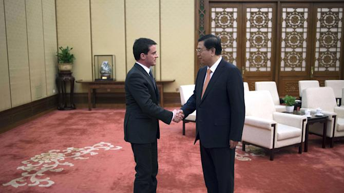 French Prime Minister Valls meets Chairman of the Standing Committee of China's National People's Congress Zhang at the Great Hall of the People in Beijing