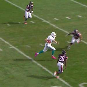 Miami Dolphins quarterback Ryan Tannehill runs for 30 on fourth down