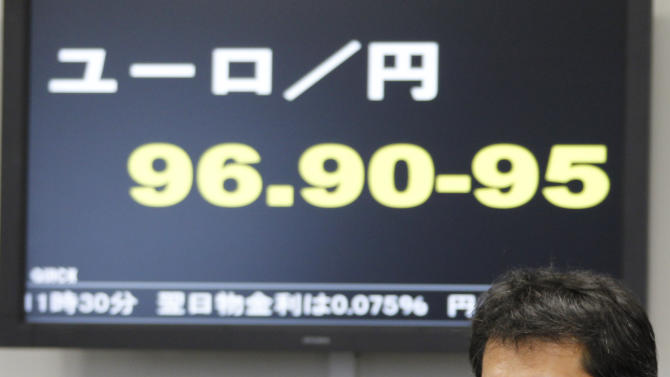 A Tokyo money brokerage employee sits in front of an electronic update board, flashing the current Japanese yen rate against a Euro at a money brokerage in Tokyo, Friday, June 1 2012. The euro has fallen nearly 7 percent in May as Europe's debt crisis intensified. The likelihood of Greece leaving the euro grew in early May when parties opposed to the terms of the country's financial rescue won at the polls. New elections are planned for next month. (AP Photo/Koji Sasahara)