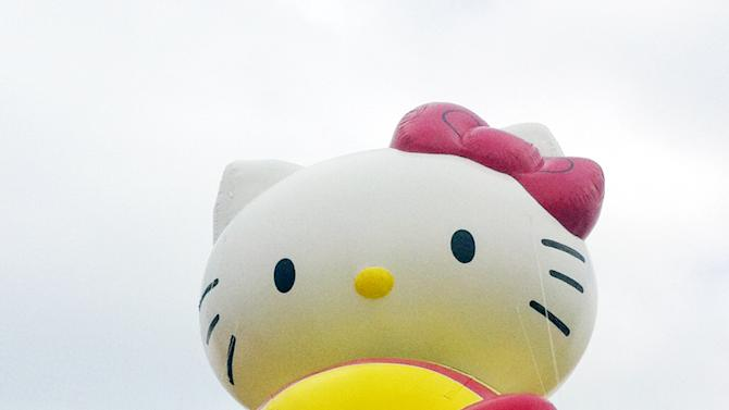 """FILE - In this Nov. 10, 2012 file photo provided by Macy's, the """"Hello Kitty"""" balloon floats over the Meadowland's race track during a test flight in East Rutherford, N.J. """"Hello Kitty"""" is one of three new balloons to be featured in the 2012 Macy's Thanksgiving Parade. (AP Photo/Macy's, Inc.)"""