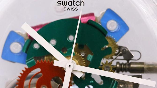 The movement of a Swatch watch is pictured in a Swatch store in Bern