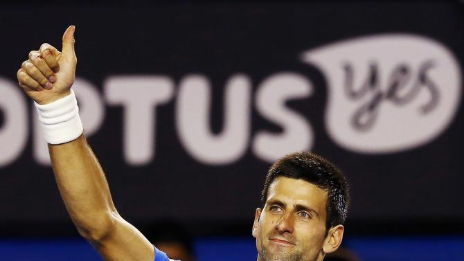 Djokovic of Serbia celebrates defeating Muller of Luxembourg in their men's singles match at the Australian Open 2015 tennis tournament in Melbourne