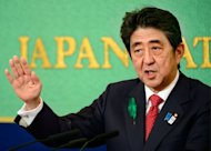 Japanese Prime Minister Shinzo Abe makes a speech at the Japan National Press Club in Tokyo on April 19, 2013. Abe unveiled new growth strategies with a special focus on expanding business opportunities for women and providing job training for young people