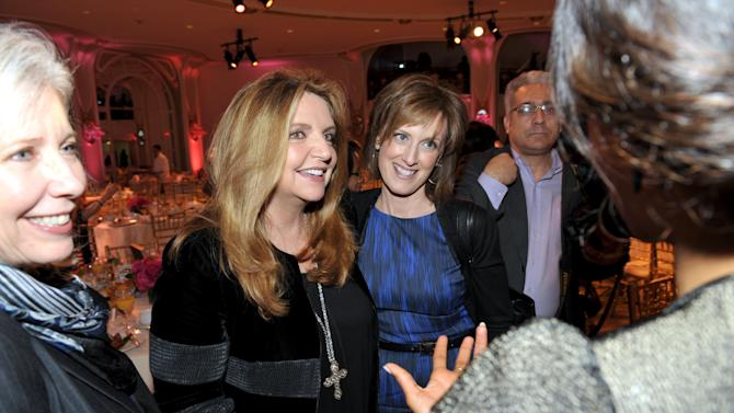Armani's Wanda McDaniel, left, and Co-chairman, Disney Media Networks and President, Disney/ABC Television Anne Sweeney attend The Hollywood Reporter's 21st Annual Women in Entertainment Power 100 breakfast presented by Lifetime on Wednesday, Dec. 5, 2012 in Beverly Hills, Calif.  (Photo by John Shearer/Invision for The Hollywood Reporter/AP Images)