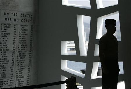 "U.S. Marine stands at attention at ""Remembrance Wall"" in Shrine Room on USS Arizona Memorial during 71st anniversary of attack on Pearl Harbor in Honolulu"