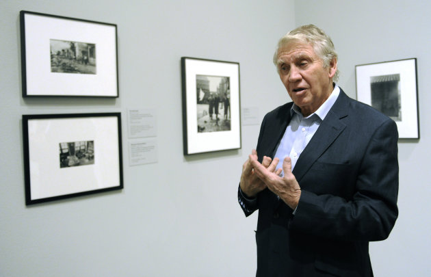 In this Thursday, Nov. 8, 2012 photo, photographer Don McCullin discusses his feelings and work as a war photographer while being interviewed at the Houston Museum of Fine Arts&#39; war photography exhibit in Houston. The exhibit includes the work of 280 photographers from 28 nations covering the Mexican-American war in 1846 to present-day. McCullin has four photos in the exhibit. (AP Photo/Pat Sullivan)
