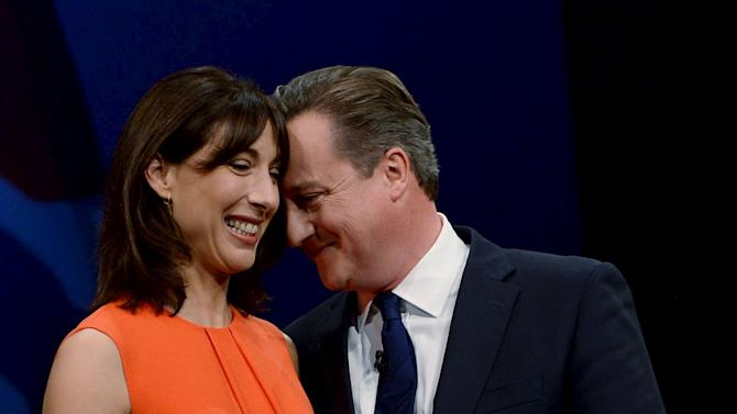 Britain's Prime Minister David Cameron stands with his wife Samantha after his address to the Conservative Party conference at in Manchester, Northern Britain