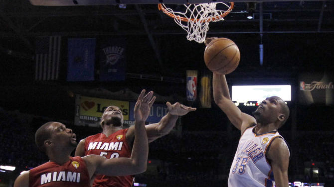 Oklahoma City Thunder small forward Kevin Durant (35) dunks as Miami Heat power forward Chris Bosh  and center Joel Anthony defend during the first half at Game 1 of the NBA finals basketball series, Tuesday, June 12, 2012, in Oklahoma City. (AP Photo/Jim Young, Pool)