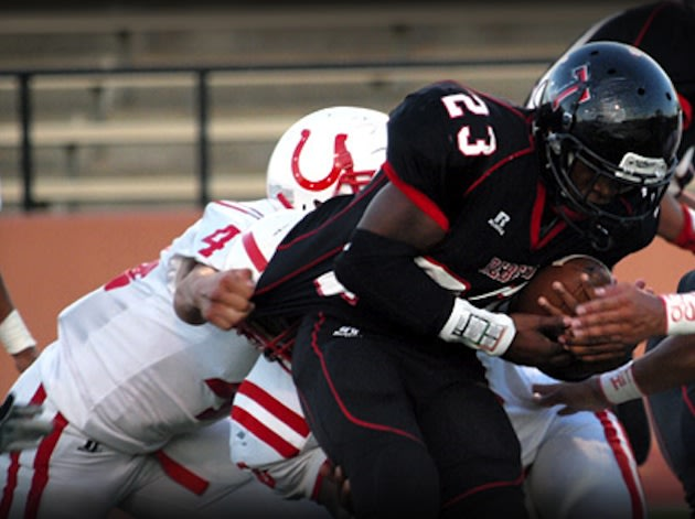 The Tascosa football team competing against a former, more nearby district rival — TascosaRebelSports.com