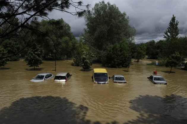 Several cars are inundated with water from the Arga River in La Magdalena, near Pamplona northern Spain, Sunday, June 9, 2013. Heavy rains have affected northern Spain in the last few days with floodi