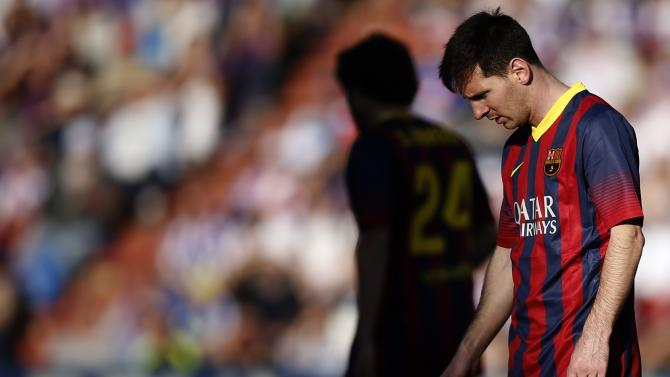 Barcelona's Messi reacts during his team's Spanish first division soccer match against Valladolid in Valladolid