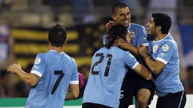 Uruguay's defender Maxi Pereira (3rd-L) celebrates with his teammates after scoring against Jordan (AFP)