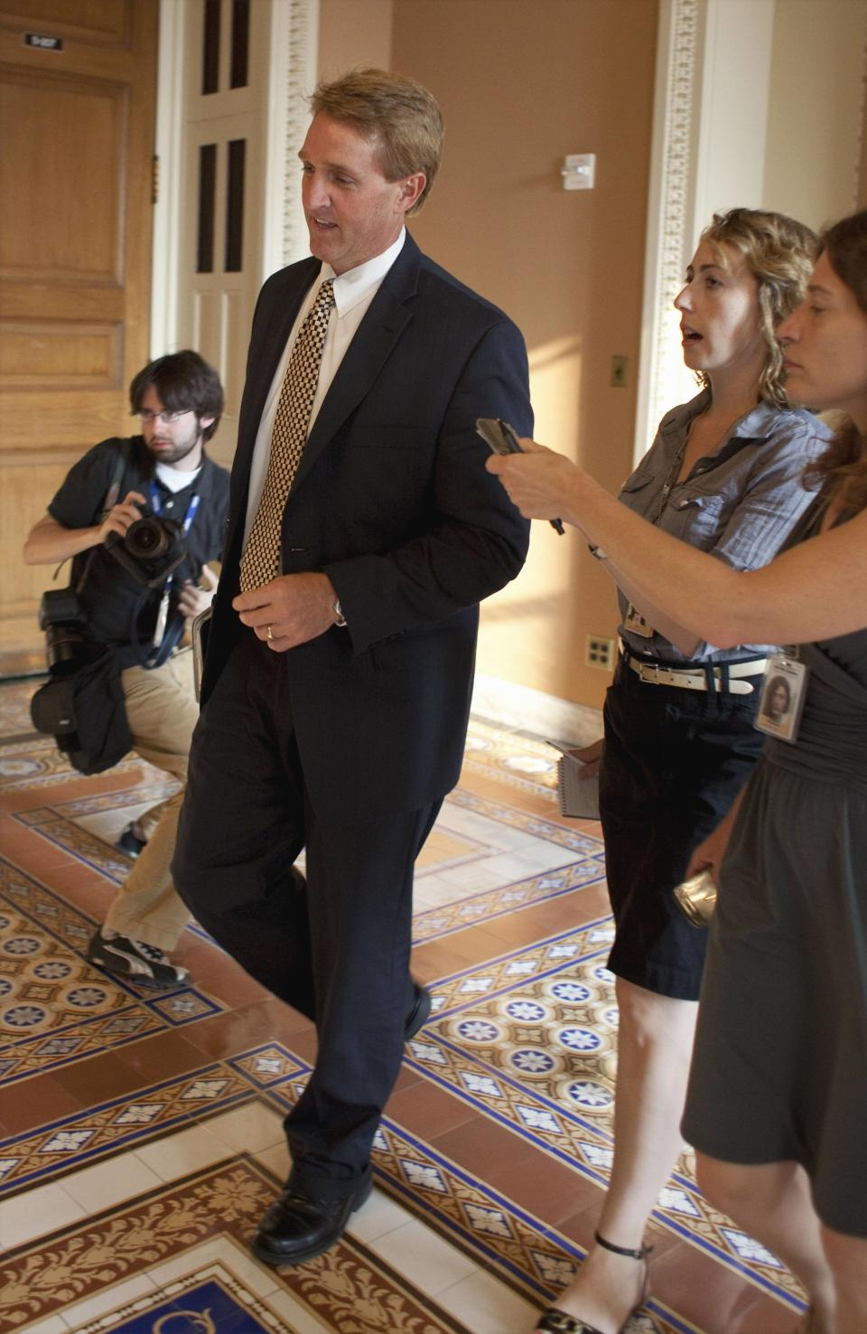 Rep. Jeff Flake, R-Ariz. speaks to reporters on Capitol Hill in Washington, Friday, July 29, 2011, after the Republican-controlled House approved emergency legislation Friday night to prevent a threatened government default and bundled it off to swift and certain defeat in the Senate. (AP Photo/Harry Hamburg)