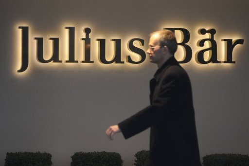 A man passes by the logo of the Swiss bank Julius Baer group at the headquarters in Zurich. Julius Baer said Monday it will acquire Merrill Lynch's International Wealth Management business outside the United States from Bank of America for some 860 million Swiss francs ($879 million, 716 million euros).