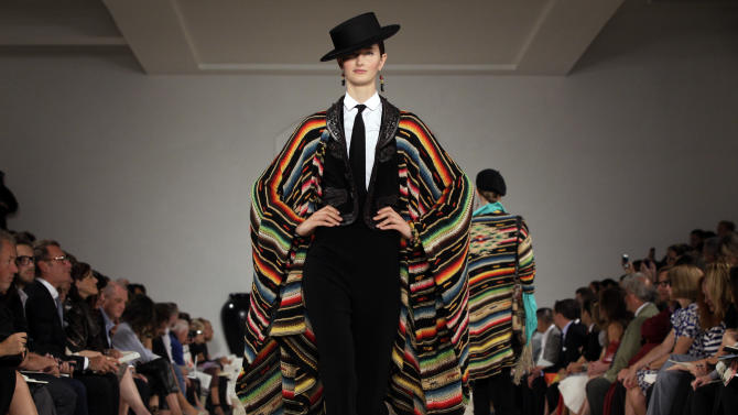 FILE - In this Thursday, Sept. 13, 2012 file photo, the Ralph Lauren Spring 2013 collection is modeled during Fashion Week in New York. Ralph Lauren is reporting their fourth quarter 2012 earnings on Wednesday, Feb. 6, 2013. (AP Photo/Richard Drew, File)