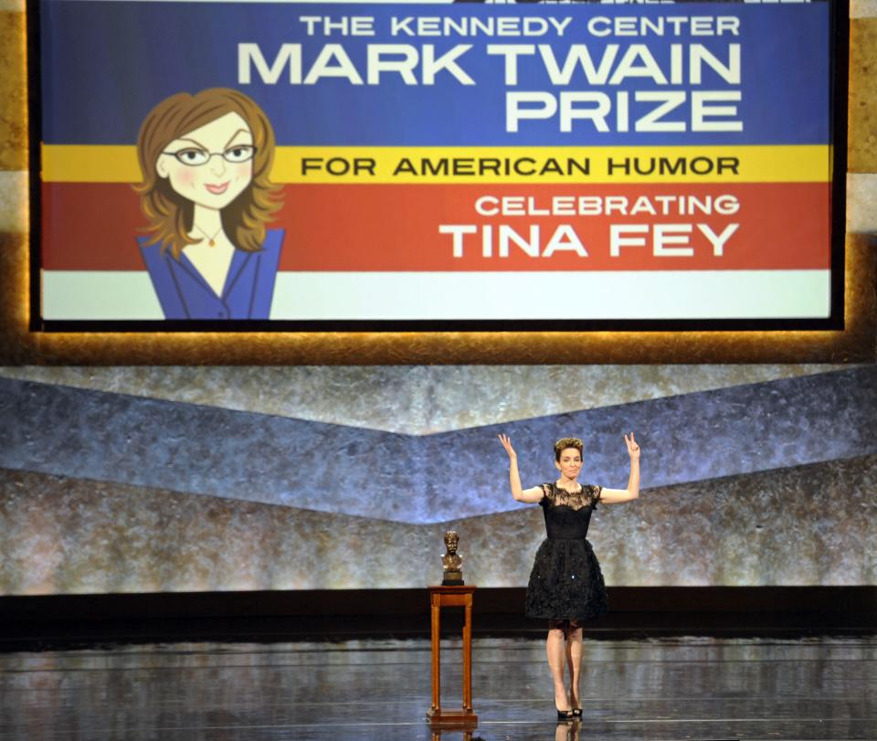 Tina Fey makes remarks after being awarded the Mark Twain Prize for American Humor at the Kennedy Center in Washington, Tuesday, Nov. 9, 2010. (AP Photo/Cliff Owen)