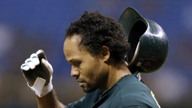 Oakland Athletics' Coco Crisp flips his helmet after being called out on strikes against Tampa Bay Rays starting pitcher Alex Cobb during the third inning of a baseball game Thursday, Aug. 23, 2012, in St Petersburg, Fla. (AP Photo/Chris O'Meara)