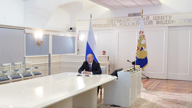 Russian President Vladimir Putin speaks during a live video link with members of Russian Geographical Society expedition to the Southern Pole in Moscow's Kremlin, Russia on Friday, Dec. 26, 2014. (AP Photo/RIA Novosti, Alexei Druzhinin, Presidential Press Service)