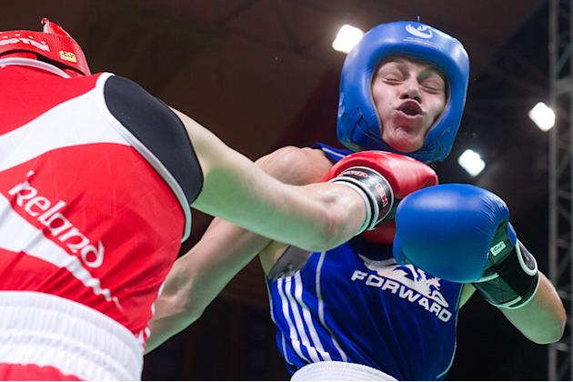Katie Taylor (L) Of Ireland Clashes AFP/Getty Images