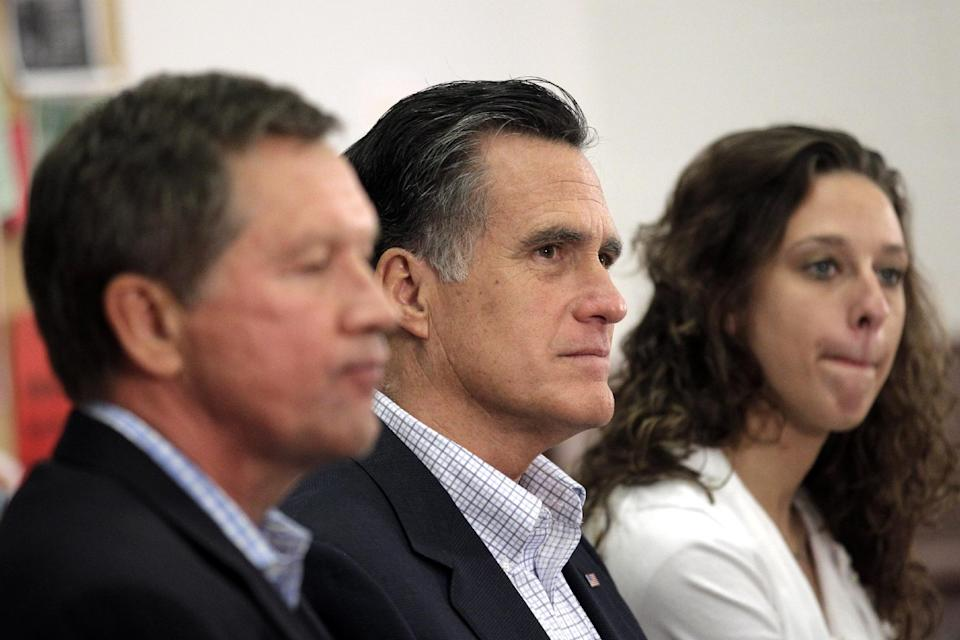 Republican presidential candidate, former Massachusetts Gov. Mitt Romney, accompanied by Ohio Gov. John Kasich, left, and student Kelsey Gorman, listens during a roundtable discussion at Otterbein University in Westerville, Ohio, Friday, April 27, 2012. (AP Photo/Jae C. Hong)