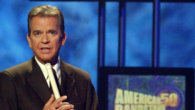 "FILE - In this April 20, 2002 file photo, Dick Clark, host of the American Bandstand television show, introduces entertainer Michael Jackson on stage during taping of the show's 50th anniversary special in Pasadena, Calif. Clark, the television host who helped bring rock `n' roll into the mainstream on ""American Bandstand,"" died  April 18, 2012 of a heart attack. He was 82. (AP Photo/Kevork Djansezian, File)"