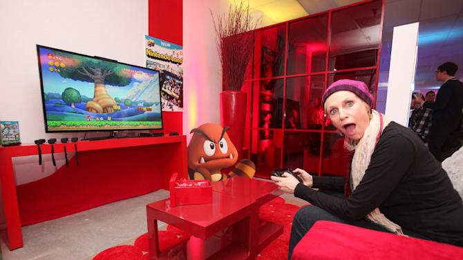 Actress Jane Lynch warms up and checks out Wii U at the Nintendo Lounge while playing New Super Mario Bros. U during a break from the Sundance Film Festival on Saturday, January 20, 2013 in Park City, UT. (Photo by Donald Traill/Invision for Nintendo/AP Images)