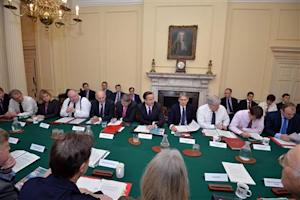 Britain's Prime Minister David Cameron speaks to members of the Cabinet before a Cabinet meeting in 10 Downing Street, central London