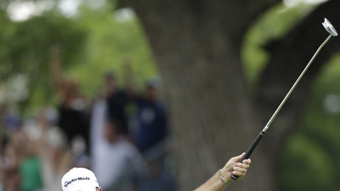 Boo Weekley reacts to sinking a birdie putt on the 13th hole during the final round of the Colonial golf tournament Sunday, May 25, 2013, in Fort Worth, Texas. (AP Photo/LM Otero)